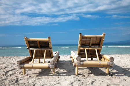 emty: Two wooden deckchairs on an emty beach in Gili islands, Indonesia Stock Photo