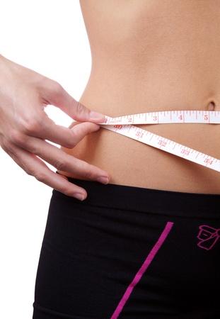 Detail of a woman measuring waist