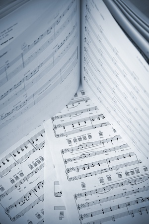 Book and papers with music notes photo