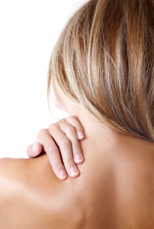 'head and shoulders': Woman holding her shoulder because of pain