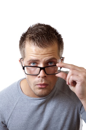 hair problem: Man adjusting his glasses to get a better view Stock Photo
