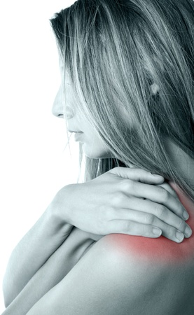 'head and shoulders': Woman pressing her hands against a painful shoulder