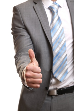 thumbsup: Businessman giving thumbs-up sign Stock Photo