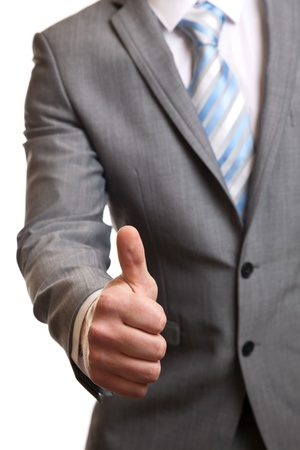 thumbsup: Businessman in suit giving thumbs-up sign