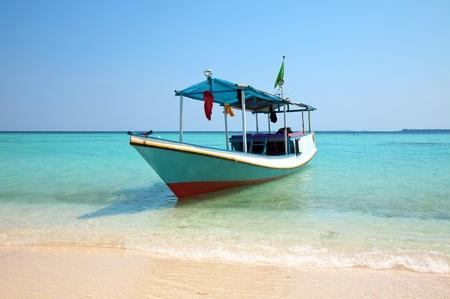 fishing scene: Boat on a beach in Karimunjawa, Indonesia