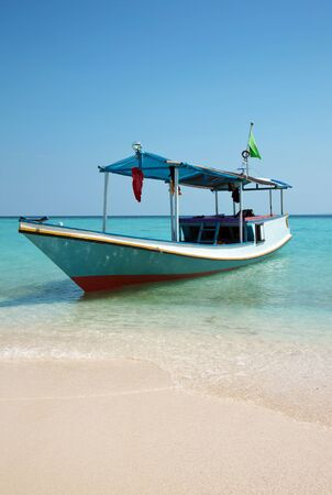 Boat on a beach in Karimunjawa, Indonesia Stock Photo - 11357260