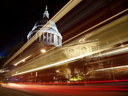 St Pauls cathedral with blurred bus trail at night photo