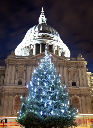 saint pauls cathedral: St Pauls cathedral with a christmas tree and bus light trails Stock Photo
