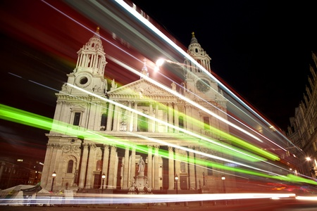 St Pauls cathedral with blurred bus trails at night photo