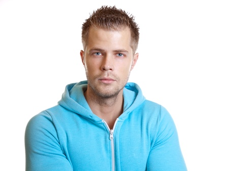 Young handsome guy wearing a hoodie, on white photo