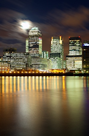 Full moon over London skyscrapers photo