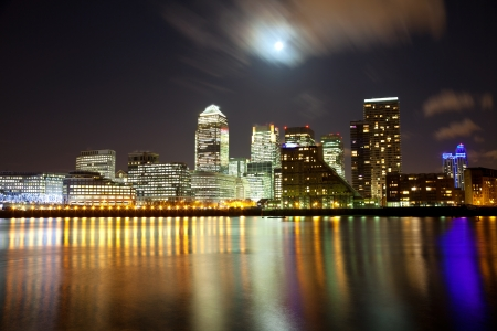 night scenery: Full moon over London skyscrapers