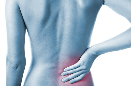 lower back pain: Woman holding her painful back Stock Photo
