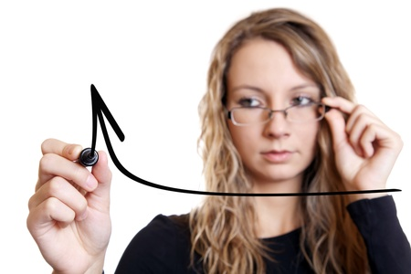 Young businesswoman drawing a graph on white, focus on pen photo