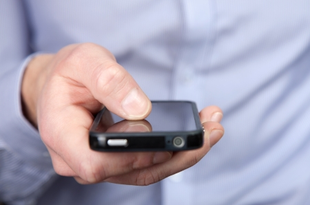 Businessman holding a smartphone in his hand