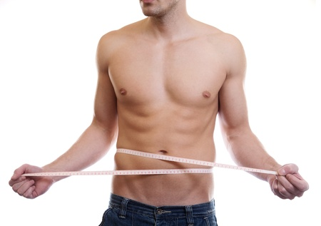 measure waist: Muscular man measuing waist on white
