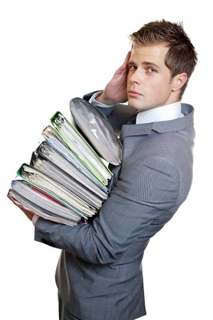too much: Stressed businessman with heavy workload