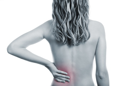lower back: Woman holding her painful back Stock Photo