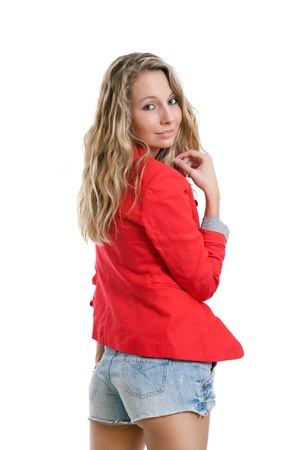 Woman in short jeans and red jacket on white photo