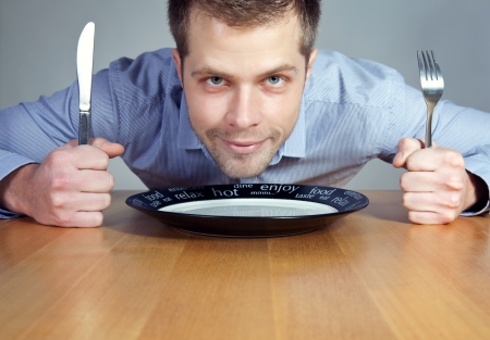young knife: Hungry man waiting for dinner