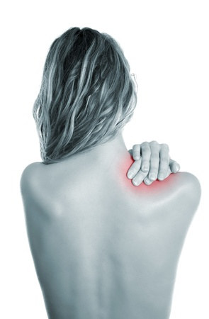 Woman holding her painful shoulder