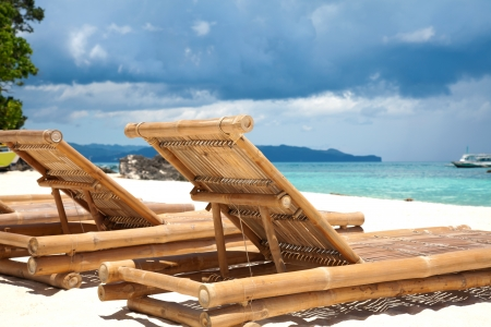 Wooden deck chairs on beach in Boracay photo