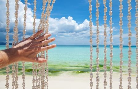 Paradise beach through a sea shell curtain Stock Photo - 14162130