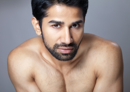 Beauty portrait of a young muscular man photo