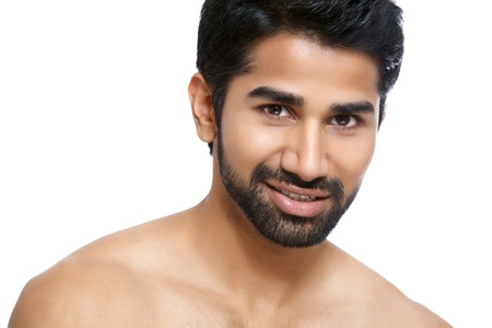 bare shoulders: Beauty portrait of a young man on white Stock Photo