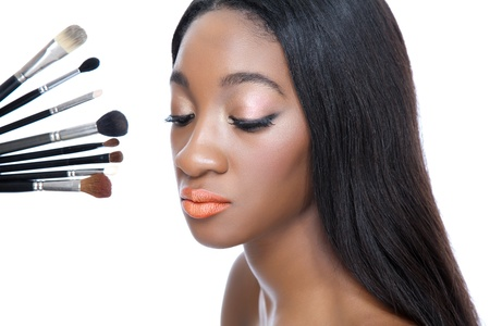 black makeup: Closeup portrait of a young African beauty and make up brushes Stock Photo