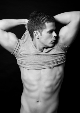six pack abs: Portriat of a handsome muscular man on black background Stock Photo