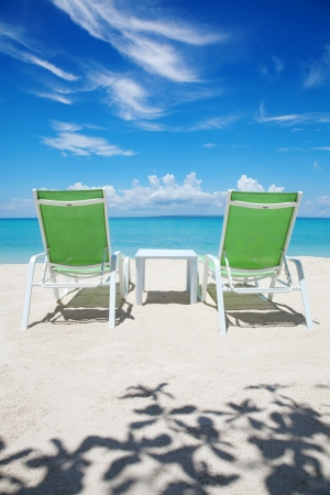 Two deckchairs on a beautiful beach photo