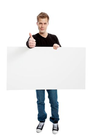 holding blank sign: Casual young man holding a blank board