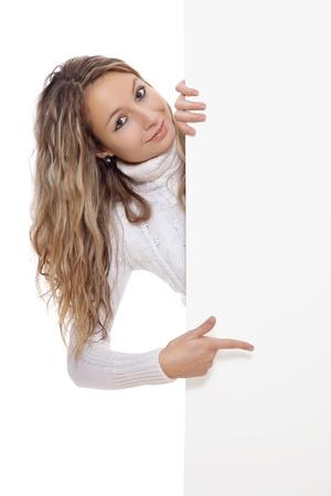 exibindo: Mulher bonita que prende uma placa vazia Banco de Imagens