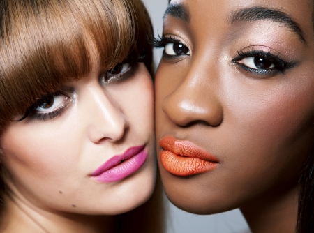 Two beautiful woman with perfect skin close together Stock Photo