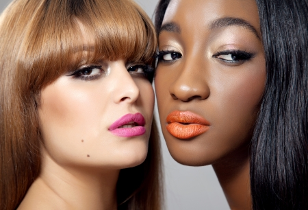 Two young beautiful women with perfect skin