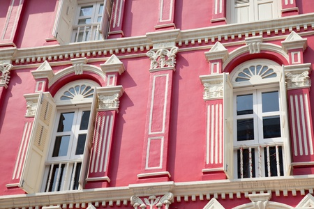 chinatown: Red building with white windows in Singapore Stock Photo