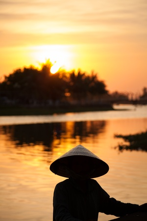 conical hat: Sunset in Hoi An, Vietnam