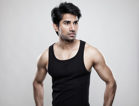 tank top: Good looking man with muscular body