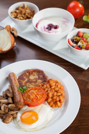 british food: English vegetarian breakfast and granola with yogurt Stock Photo