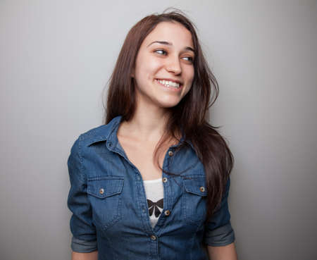 unbuttoned: Portrait of a happy looking young woman  Stock Photo