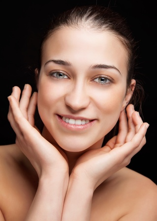 touching face: Young beautiful woman with perfect skin