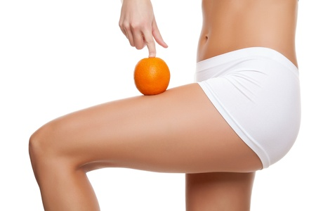 cellulite: Woman with an orange showing a perfect skin without cellulitis