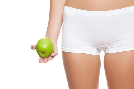 Woman holding an apple without signs of cellulitis photo
