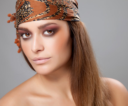 Young beautiful woman with a headscarf photo
