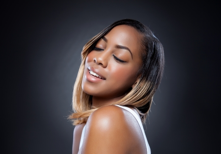 beauty skin: Attractive black beauty with perfect skin smiling
