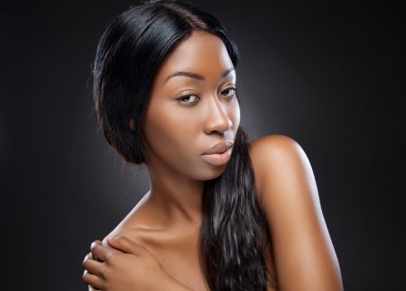 Young beautiful black woman with long hair Stock Photo
