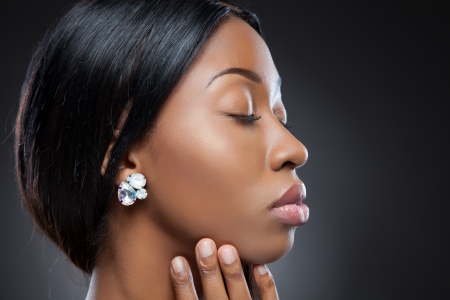 Profile of an young black beauty with perfect skin photo