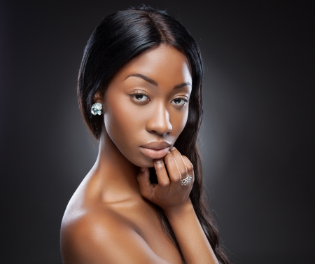 woman long hair: Young beautiful black woman with long hair Stock Photo