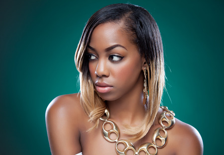 Attractive black woman wearing a golden necklace photo